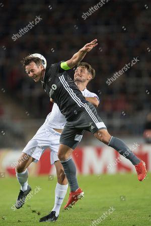 Rosenborg's  Mike Jensen (L) in action against Lask's James Holland (R) during the UEFA Europa League group D soccer match between LASK and Rosenborg BK, in Linz, Austria, 19 September 2019.