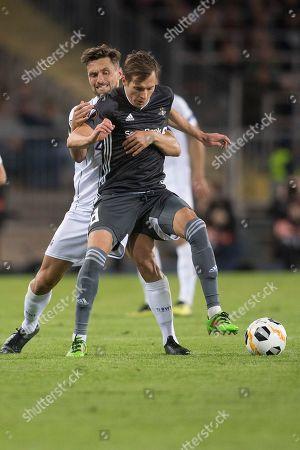 Lask's James Holland (L) in action against Rosenborg's  Anders Konradsen (R) during the UEFA Europa League group D soccer match between LASK and Rosenborg BK, in Linz, Austria, 19 September 2019.