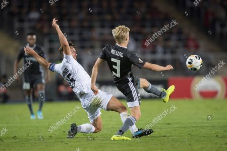 Lask's James Holland (L) in action against Rosenborg's  Birger Meling (R) during the UEFA Europa League group D soccer match between LASK and Rosenborg BK, in Linz, Austria, 19 September 2019.