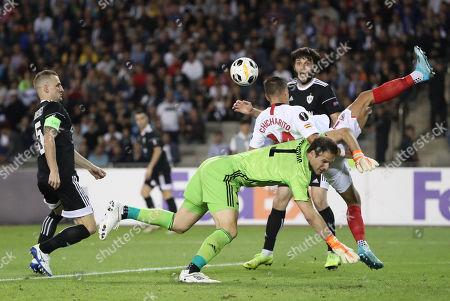 Javier Hernandez (C) of Sevilla in action against qarabag's goalkeeper Asmir Begovic during the UEFA Europa League group A match Qarabag vs Sevilla in Baku, Azerebaijan, 19 September 2019.