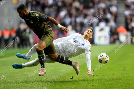 Lugano's player Carlinhos Junior, left, fight for the ball with Copenhagen's player Guillermo Varela, right, during the UEFA Europa League soccer match FC Copenhagen vs FC Lugano in Copenhagen, Denmark, 19 September 2019.