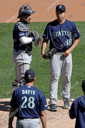 Yusei Kikuchi, Omar Narvaez, Paul Davis. Seattle Mariners starting pitcher Yusei Kikuchi (18) waits with catcher Omar Narvaez, left, as they wait for visit from pitching coach Paul Davis (28) during the fourth inning of a baseball game against the Pittsburgh Pirates in Pittsburgh