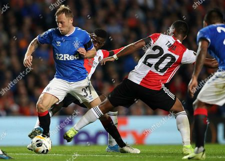 XEUROPALEAGUEX. Rangers Scott Arfield, left, vies for the ball with Feyenoord's Renato Tapia, right, during the Europa League group G soccer match between Rangers and Feyenoord at Ibrox, Glasgow, Scotland
