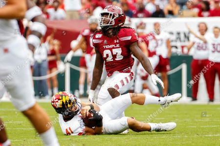 Harrison Hand, Mike Shinsky. Temple cornerback Harrison Hand (23) stops Maryland place kicker Mike Shinsky (41) on the fake field goal during the first half of an NCAA college football, in Philadelphia. Temple won 20-17