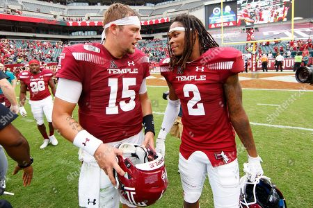 Anthony Russo, Isaiah Wright. Temple quarterback Anthony Russo (15) talks with wide receiver Isaiah Wright (2) following the second half of an NCAA college football against Maryland, in Philadelphia. Temple won 20-17
