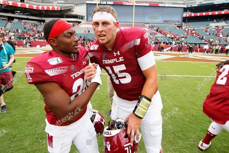Anthony Russo, Travon Williams. Temple quarterback Anthony Russo (15) celebrates the win with Temple wide receiver Travon Williams (26) following the second half of an NCAA college football against Maryland, in Philadelphia. Temple won 20-17