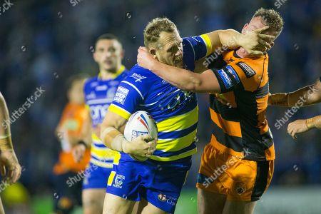 Ben Westwood of Warrington is tackled by Adam Milner of Castleford.