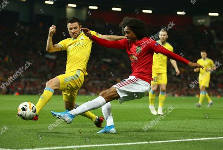 Stock Picture of Astana's Antonio Rukavina, left, competes for the ball with Manchester United's Tahith Chong during the Europa League Group L soccer match between Manchester United and Astana at Old Trafford stadium in Manchester, England