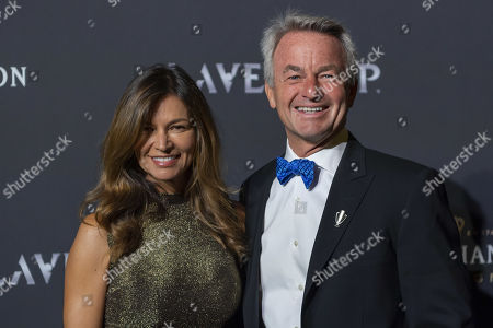 Stock Photo of Tony Godsick (R), agent of Roger Federer and President and CEO of TEAM8 and Chairman of the Laver Cup and his wife Mary Joe Fernandez poseon the red carpet at Gala night, during the Laver Cup in Geneva, Switzerland, 19 September 2019. The competition will pit a team of the best six European players against the top six from the rest of the world. The Laver Cup edition is scheduled for Sept. 20-22 at the Palexpo in Geneva. The Laver Cup is named after the Australian tennis legend Rod Laver.