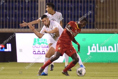 Player of Damac Samuel Aso  (L) in action for the ball with Al-Shabab player Alfred Ndiaye(R) during the Saudi Professional League soccer match between Damac and Al Shabab at Prince Sultan Bin Abdulaziz Sports City Stadium , Khamis Mushait , Saudi Arabia, 19 September 2019.