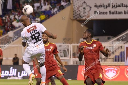 Player of Damac Hassan Jafari (L) in action for the ball with Al-Shabab playerSebastiao Junior (R) during the Saudi Professional League soccer match between Damac and Al Shabab at Prince Sultan Bin Abdulaziz Sports City Stadium , Khamis Mushait , Saudi Arabia, 19 September 2019.