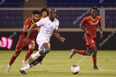 Player of DamacHassan Jafari (L) in action for the ball with Al-Shabab player Sebastiao Junior (R) during the Saudi Professional League soccer match between Damac and Al Shabab at Prince Sultan Bin Abdulaziz Sports City Stadium , Khamis Mushait , Saudi Arabia, 19 September 2019.