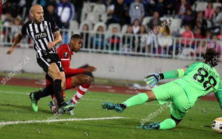 AZ Alkmaar's Myron Boadu (C) scores against Partizan?s Nemanja Miletic (L) and Partizan?s goalkeeper Vladimir Stojkovic (R) during the UEFA Europa League soccer match between Partizan Belgrade and AZ Alkmaar in Belgrade, Serbia, 19 September 2019.