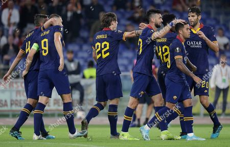 Roma players celebrate after their teammate Edin Dzeko scored their side's second goal during a group J Europa League soccer match between Roma and Istanbul Basaksehir, at Rome's Olympic Stadium