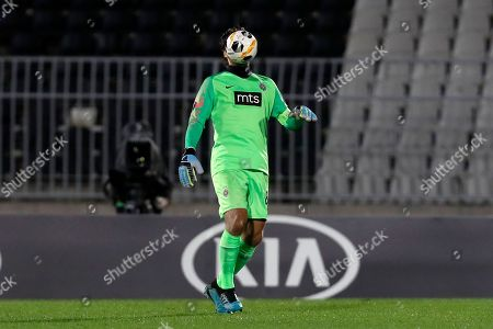 Partizan's goalkeeper Vladimir Stojkovic heads the ball during the Europa League group L soccer match between Partizan and AZ Alkmaar at the Partizan stadium in Belgrade, Serbia