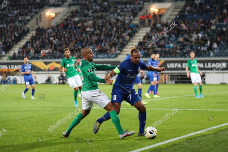 Saint-Etienne's Wahbi Khazri, left, vies for the ball with Gent's Vadis Odjidja-Ofoe the Europa League group I soccer match between Gent and Saint Etienne at KAA Gent Stadium in Ghent, Belgium, . Gent won 3-2