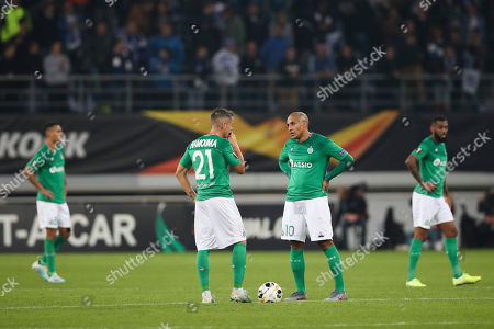 Saint-Etienne's Wahbi Khazri, right, talks to teammate Romain Hamouma after Gent scored its third goal during the Europa League group I soccer match between Gent and Saint Etienne at KAA Gent Stadium in Ghent, Belgium, . Gent won 3-2