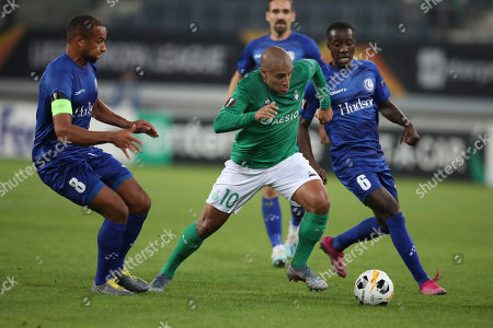 Saint-Etienne's Wahbi Khazri, centre, vies for the ball with Gent's Vadis Odjidja-Ofoe, left, and Elisha Owusu during the Europa League group I soccer match between Gent and Saint Etienne at KAA Gent Stadium in Ghent, Belgium