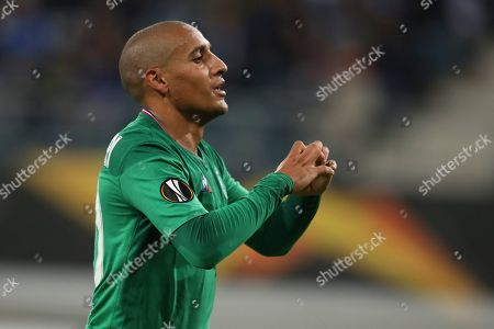 Saint-Etienne's Wahbi Khazri celebrates after scoring his side's first goal during the Europa League group I soccer match between Gent and Saint Etienne at KAA Gent Stadium in Ghent, Belgium