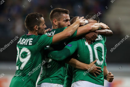 Saint-Etienne's Wahbi Khazri, right, celebrates with teammates after scoring his side's first goal during the Europa League group I soccer match between Gent and Saint Etienne at KAA Gent Stadium in Ghent, Belgium