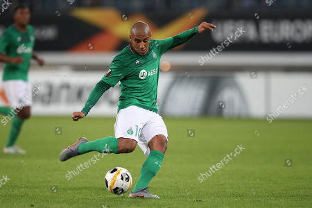 Saint-Etienne's Wahbi Khazri shoots to score his side's first goal during the Europa League group I soccer match between Gent and Saint Etienne at KAA Gent Stadium in Ghent, Belgium, . Gent won 3-2