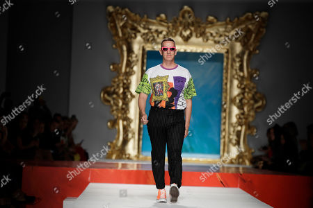 Designer Jeremy Scott accepts applause at the conclusion of the Moschino Spring-Summer 2020 collection, unveiled during the fashion week, in Milan, Italy