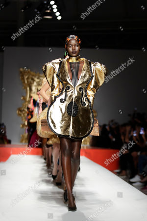 Model Alek Wek wears a creation as part of the Moschino Spring-Summer 2020 collection, unveiled during the fashion week, in Milan, Italy