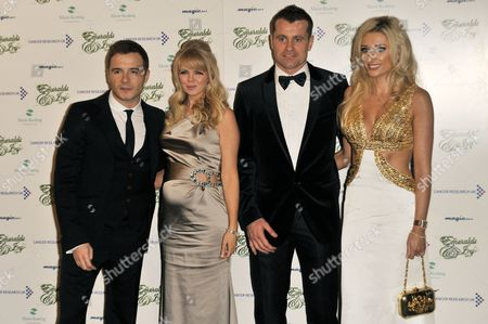 Shane Filan with wife Gillian Filan and Shay Given with wife Jane