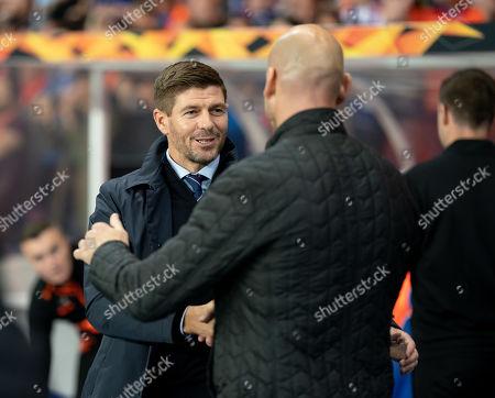 Rangers Manager Steven Gerrard greets Feyenoord Manager Jaap Stam.