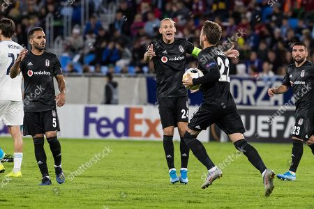 (L-R) Besiktas«s players Douglas, Domagoj Vida and Adem Ljajic celebrate during the UEFA Europa League group K soccer match between SK SLovan Bratislava and Besiktas JK in Bratislava, Slovakia, 19 September 2019.