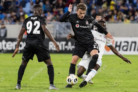 Besiktas«s player Adem Ljajic (C) and SK Slovan player Rabiu Ibrahim (R) in action during the UEFA Europa League group K soccer match between SK SLovan Bratislava and Besiktas JK in Bratislava, Slovakia, 19 September 2019.