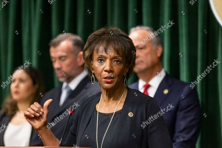 Los Angeles County District Attorney, Jackie Lacey, takes question about the arrest of Ed Buck the prominent LGBTQ political activist, during a news conference in Los Angeles, . Federal prosecutors will ask a judge to hold Buck without bond pending his trial on charges connected to a drug death at his Los Angeles-area home