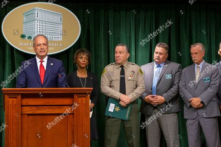 Nick Hanna, Jackie Lacey, Alex Villanueva, Pat Nelson, Kent Wegener. U.S. Attorney Nick Hanna, from left, at podium, with Los Angeles County District Attorney, Jackie Lacey, Sheriff Alex Villanueva, Chief-Detective Division Lt. Pat Nelson, and Homicide Bureau Capt. Kent Wegener listen to questions at a news conference about the arrest of Ed Buck, the prominent LGBTQ political activist, in Los Angeles, . Federal prosecutors will ask a judge to hold Buck without bond pending his trial on charges connected to a drug death at his Los Angeles-area home