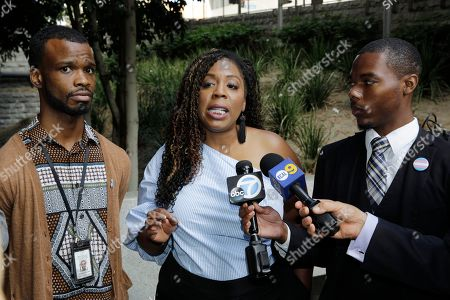 Jerome Kitchen, Jasmyne Cannick, David Cunningham. Activist Jasmyne Cannick, co-founder of the National Black Justice Coalition, the nation's largest and oldest Black lesbian, gay, bisexual and transgender civil rights organization, middle, is joined by gay activists, Jerome Kitchen, godbrother of Gemmel Moore the first victim, left, and David Cunningham, a law student, right, comment on the arrest of Los Angeles area gay activist Ed Buck outside the Clara Shortridge Foltz Criminal Justice Center in Los Angeles