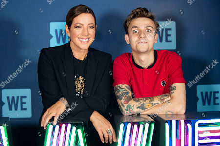 Stock Photo of Sarah McLachlan, Scott Helman. Singer/songwriters Sarah McLachlan, left, and Scott Helman pose during WE Day Toronto at the Scotiabank Arena, in Toronto