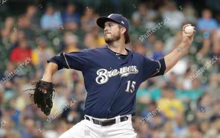 Stock Photo of Milwaukee Brewers' Drew Pomeranz throws during the seventh inning of a baseball game against the San Diego Padres, in Milwaukee