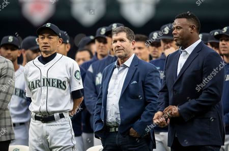 Ichiro Suzuki, Ken Griffey Jr., Edgar Martinez. Former Seattle Mariners players, from left, Ichiro Suzuki, Edgar Martinez and Ken Griffey Jr. stand on the field during a ceremony in which Suzuki was given the Franchise Achievement Award before a baseball game between the Chicago White Sox and the Seattle Mariners, in Seattle. The Mariners won 2-1 in ten innings