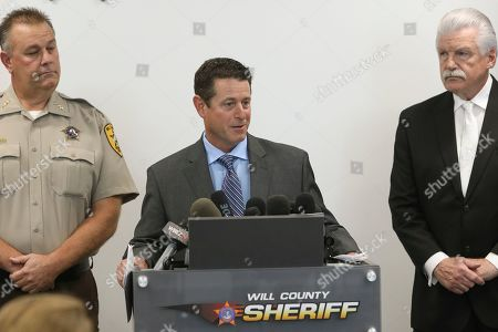 Stock Photo of Will County County Coroner Patrick O'Neil speaks at a news conference accompanied by Will County Sheriff Mike Kelley, left, and Will County State's Attorney James Glasgow, right, in Joliet, Ill. Authorities have found no fetal remains at a shuttered abortion clinic once operated by the late abortion Dr. Ulrich Klopfer whose Illinois property was found to contain more than 2,200 medically preserved fetal remains