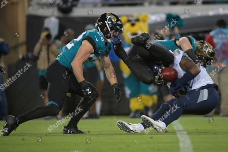 Tennessee Titans cornerback Adoree' Jackson (25) fumbles the football against the Jacksonville Jaguars during the first half of an NFL football game, in Jacksonville, Fla