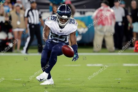 Tennessee Titans cornerback Adoree' Jackson fumbles a Jacksonville Jaguars punt during the first half of an NFL football game, in Jacksonville, Fla