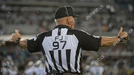 NFL field judge Tom Hill (97) during the second half of an NFL football game between the Jacksonville Jaguars and the Tennessee Titans, in Jacksonville, Fla