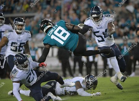 Jacksonville Jaguars wide receiver Chris Conley (18) is sent flying by Tennessee Titans inside linebacker Rashaan Evans (54) during the second half of an NFL football game, in Jacksonville, Fla