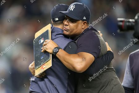 Aaron Boone, CC Sabathia. New York Yankees starting pitcher CC Sabathia, right, embraces manager Aaron Boone after defeating the Los Angeles Angels and clinching the AL East baseball title, in New York