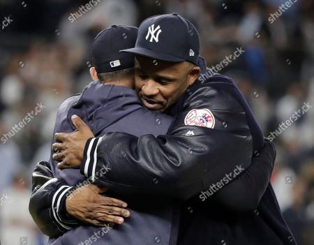 New York Yankees starting pitcher CC Sabathia (R) hugs New York Yankees manager Aaron Boone (L) after their team defeated the Los Angeles Angels to become the American League East Division Champions during the MLB game between the Los Angeles Angels and the New York Yankees at Yankee Stadium in the Bronx, New York, USA, 19 September 2019.