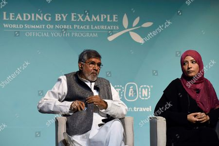Indian Nobel Peace Prize laureate Kailash Satyarthi (L) and Yemeni Nobel Peace Prize laureate Tawakel Karman (R) participate in a lecture at the World Summit of Nobel Peace Laureates in Merida, Mexico, 19 September 2019. The summit will be held from 19 September to 22 September 2019.
