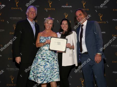 """John Ziffren, Marti Noxon, Jessica Rhoades, Emmanuelle Vaugier. Television Academy Producers Peer Group Governor John Ziffren, left, with Emmy Nominees for Outstanding Limited Series for """"Sharp Objects,"""" Marti Noxon, second from left, Jessica Rhoades and Emmanuelle Vaugier at the 2019 Producers Nominee Reception, in West Hollywood, Calif"""