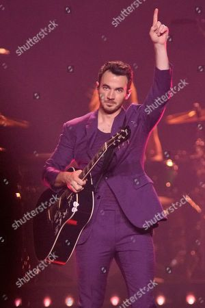 """Kevin Jonas of The Jonas Brothers performs during their """"Happiness Begins Tour"""" at the United Center, in Chicago"""