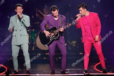 """Nick Jonas, Kevin Jonas, Joe Jonas. Nick Jonas, from left, Kevin Jonas, and Joe Jonas, of The Jonas Brothers, perform during their """"Happiness Begins Tour"""" at the United Center on"""