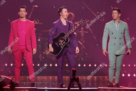"""Nick Jonas, Kevin Jonas, Joe Jonas. Joe Jonas, from left, Kevin Jonas, and Nick Jonas, of The Jonas Brothers, perform during their """"Happiness Begins Tour"""" at the United Center on"""