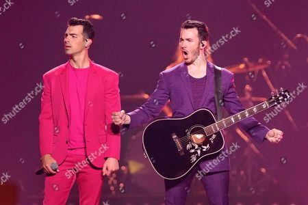 """Stock Photo of Kevin Jonas, Joe Jonas. Joe Jonas, left, and Kevin Jonas of the Jonas Brothers, perform during their """"Happiness Begins Tour"""" at the United Center, in Chicago"""